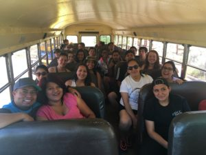 NMDT members on the bus to go river rafting